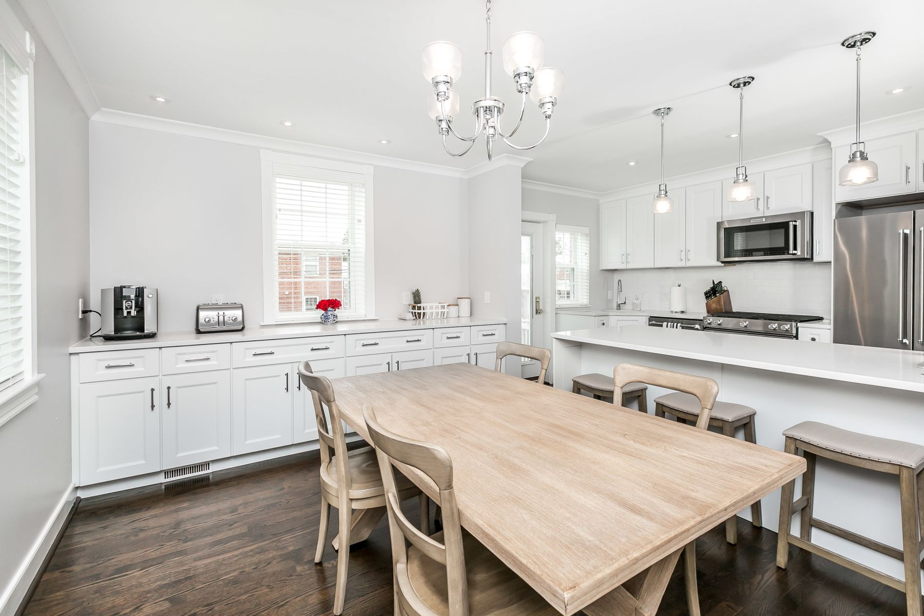 Kitchen view with table and granite counter tops